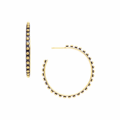 Gold hoop earrings with small studded burnished gold dots, offered in multiple sizes.