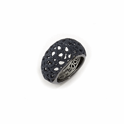 Small Dome Laser Cut Polvere Di Sogni Ring. Sterling Silver with a Ruthenium plating. Ring features butterfly tines  along interior of the  ring for easy sizing.