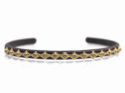 Old World blackened sterling silver/18k yellow gold eternity Crivelli cuff bracelet with white diamonds. Diamond weight - 0.08 ct.Metal: .925 Sterling Silver/18k Yellow Gold