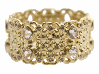 Collection: Sueno Style #: 13310 Description: Sueno 18k yellow gold double-scroll wide band ring with white diamonds and white sapphires. Diamond weight - Diamond weight - 0.18 ct.Metal: 18k Yellow Gold