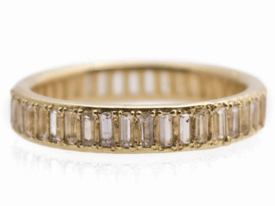 Collection: SuenoStyle #: 13429Description: Sueno 18k yellow gold wide channel-set white sapphire baguette ring.Metal: 18k Yellow Gold