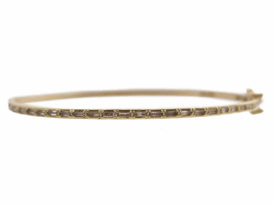 Collection: SuenoStyle #: 13804Description: Sueno 18k yellow gold thin huggie bracelet with white sapphire baguettes.Metal: 18k Yellow Gold