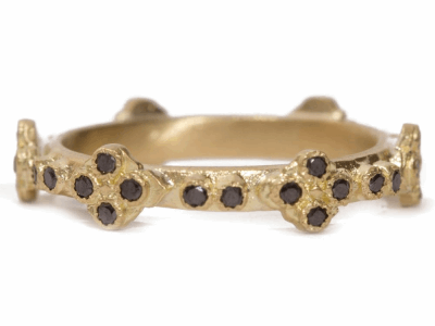 Collection: SuenoStyle #: 07390Description: 18k Yellow gold black diamond cravelli stack ring.Metal: 18k Yellow Gold