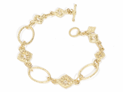 "Collection: Sueno Style #: 06844 Description: 18k Yellow gold 7.5"" variegated oval and scroll station bracelet with champagne diamonds. Diamond Weight 0.29ctMetal: 18k Yellow Gold"