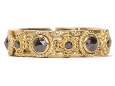 Collection: Sueno Style #: 06725 Description: 18k Yellow gold wide band ring with rose-cut black diamonds and 1mm black diamonds. Diamond Weight 0.9ctMetal: 18k Yellow Gold