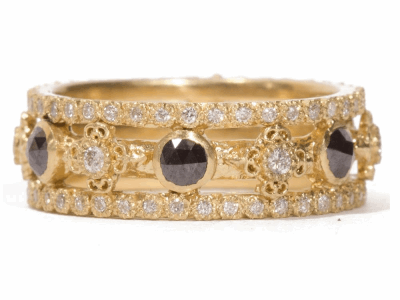 Collection: Sueno Style #: 06691 Description: 18k Yellow gold open sculpted triple-band ring with rose-cut black diamonds and white diamonds. Diamond Weight 1.18ctMetal: 18k Yellow Gold