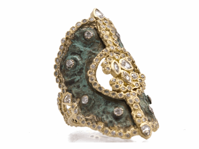 Collection: Sueno Style #: 9635 Description: Sueno 18k yellow gold large artifact saddle disc ring with white diamonds and white sapphires.Metal: 18k Yellow Gold