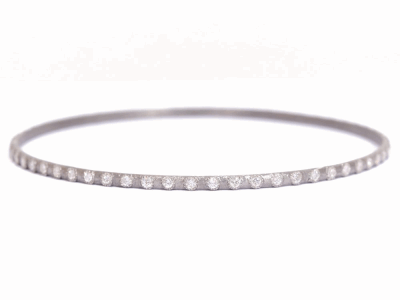Collection: New WorldStyle #: 02867Description: New World eternity diamond bangle bracelet with 1.7mm white diamonds.Metal: .925 Sterling Silver