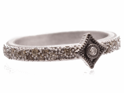 Collection: New WorldStyle #: 10719Description: New World Oxidized Sterling Silver and sterling silver single crivelli band ring with pave champagne diamonds. Diamond Weight 0.22ct