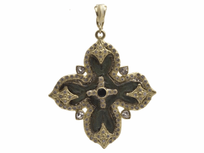 Collection: Old World Style #: 11713 Description: Sueno 18k yellow gold 24mm wide cross artifact enhancer with center tourmaline, white diamonds and white sapphires. Diamond Weight 0.46ct