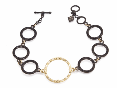 "Collection: Old World Style #: 13568 Description: Old World blackened sterling silver/18k yellow gold 7""-7.5"" circle-link bracelet with white and black sapphire baguettes and white diamonds. Diamond weight - 0.02 ct.Metal: .925 Sterling Silver/18k Yellow Gold"