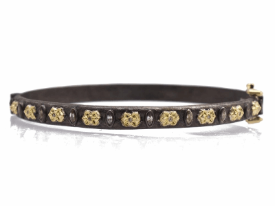 Collection: Old World Style #: 13803 Description: Old World blackened sterling silver/18k yellow gold Fleur-de-Lis and marquis white sapphire huggie bracelet with champagne diamonds. Diamond weight - 0.05 ct.Metal: .925 Sterling Silver/18k Yellow Gold