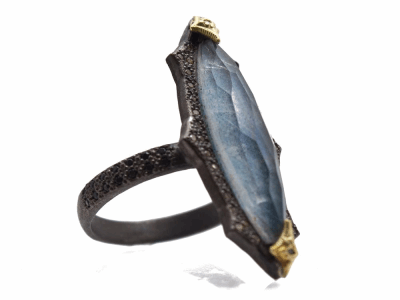 Collection: Old World Style #: 13968 Description: Old World blackened sterling silver/18k yellow gold 24x6mm pointed crivelli marquis ring with Blue Quartz/Labradorite/White Quartz triplet, champagne diamonds and black sapphires. Diamond weight - 0.15 ct.Metal: .925 Sterling Silver/18k Yellow Gold