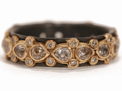 Collection: Old World Style #: 16880 Description: Old World blackened sterling silver/18k yellow gold lacy eternity stack ring w/ white pear shaped sapphires and champagne diamonds.Metal: .925 Sterling Silver/18k Yellow Gold