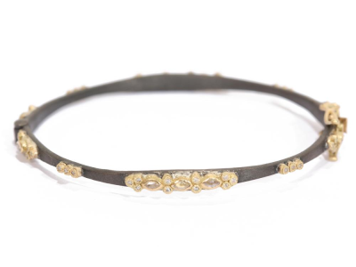 Collection: Old World Style #: 25210 Description: Old World blackened sterling silver/18k yellow gold lacy huggie bracelet with white sapphires and champagne diamonds.Metal: .925 Sterling SilverS/18k Yellow Gold