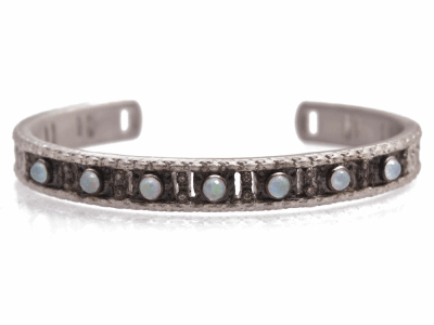 Collection: Old World Style #: 12780 Description: New World blackened sterling silver/sterling silver carved cuff bracelet with White MOP/Opal/Ice Quartz triplets and champagne diamonds.
