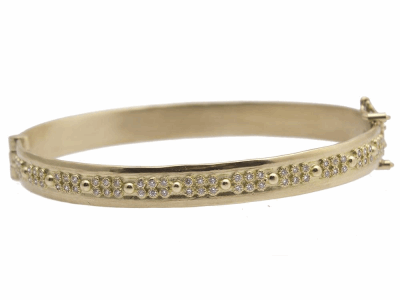 Collection: Old World Style #: 11620 Description: Sueno 18k yellow gold double-layer huggie bracelet with white diamonds. Diamond Weight 0.33ct