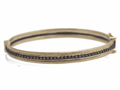 Collection: Old World Style #: 11706 Description: Old World blackened sterling silver/18k yellow gold wide single-row huggie bracelet with champagne diamonds. Diamond Weight 0.28ct
