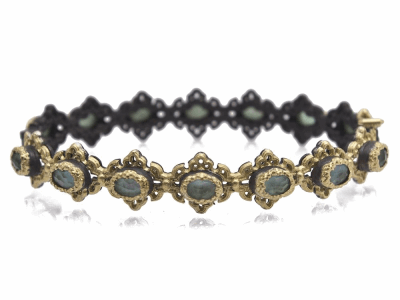 Collection: Old World Style #: 11704 Description: Old World blackened sterling silver/18k yellow gold scroll huggie bracelet with Emerald/White MOP/White Quartz triplet stones.