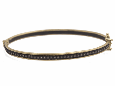 Collection: Old World Style #: 11707 Description: Old World blackened sterling silver/18k yellow gold skinny single-row huggie bracelet with diamonds. Diamond Weight 0.28ct