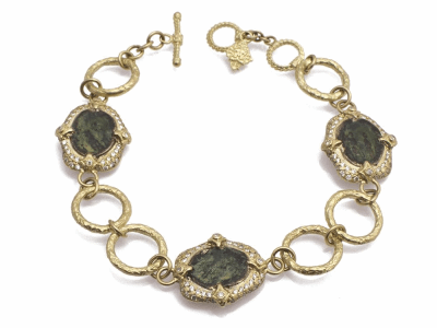 "Collection: Old WorldStyle #: 11719Description: Sueno 18k yellow gold 7.5"" oval artifact link bracelet with pave white diamonds. Diamond Weight 0.86ct"