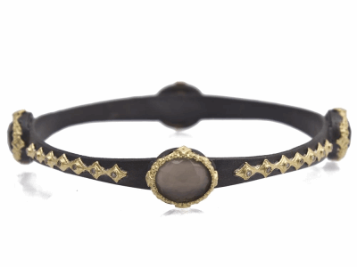 Collection: Old World Style #: 11763 Description: Old World blackened sterling silver/18k yellow gold oval scalloped bangle bracelet with Foil triplet and champagne diamonds. Diamond Weight 0.34ct