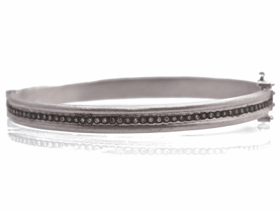 Collection: Old WorldStyle #: 11909Description: New World blackened sterling silver/sterling silver wide single-row huggie bracelet with champagne diamonds. Diamond Weight 0.28ct