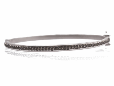 Collection: Old WorldStyle #: 11908Description: New World blackened sterling silver/sterling silver skinny single-row huggie bracelet with champagne diamonds. Diamond Weight 0.31ct