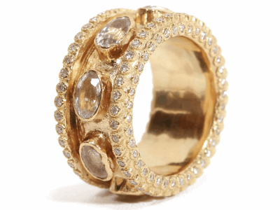 Collection: Old WorldStyle #: 01608Description: Large (.25cts) band ring with white sapphires and white diamonds.Metal: 18k Yellow Gold