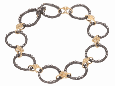 Collection: Old World Style #: 02601 Description: Old World Dulcinea circle link bracelet with diamonds and Yellow Gold cravelli stations.Metal: .925 Sterling SilverS/18k Yellow Gold