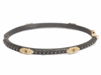 Collection: Old World Style #: 03441 Description: Old World huggie bracelet with 6 Yellow Gold scroll stations and 1mm black and white diamonds & 1.7mm black diamonds.Metal: .925 Sterling SilverS/18k Yellow Gold