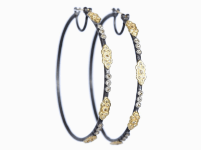 Collection: Old World Style #: 03581 Description: Blackened sterling silver and 18k yellow gold 52mm scroll hoop earrings with champagne diamonds. Diamond Weight 0.842 ct.Metal: .925 Sterling SilverS/18k Yellow Gold