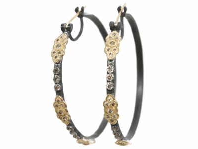 Collection: Old World Style #: 03457 Description: Blackened sterling silver and 18k yellow gold 35mm scroll hoop earrings with champagne diamonds. Diamond Weight 0.594 ct.Metal: .925 Sterling SilverS/18k Yellow Gold
