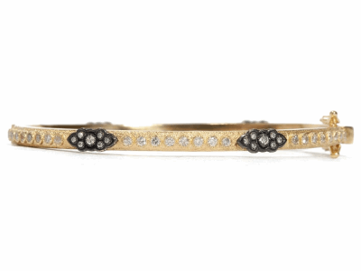 Collection: Old World Style #: 04575 Description: 18k Yellow gold and blackened sterling silver scroll huggie bracelet with white diamonds. Diamond Weight 1.136 ct.Metal: .925 Sterling SilverS/18k Yellow Gold