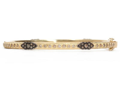 Collection: Old World Style #: 04574 Description: 18k Yellow gold and blackened sterling silver scroll huggie bracelet with champagne diamonds. Diamond Weight 1.396 ct.Metal: .925 Sterling SilverS/18k Yellow Gold