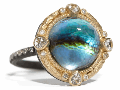 Collection: Old World Style #: 04693 Description: Blackened sterling silver and 18k yellow gold round 12mm Mother of Pearl/Blue Topaz and diamond ring on blackened sterling silver eternity diamond band.Metal: .925 Sterling SilverS/18k Yellow Gold