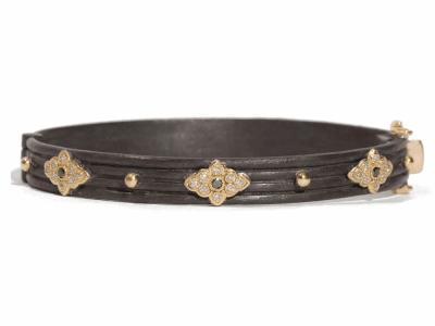 Collection: Old World Style #: 05158 Description: Blackened sterling silver and 18k yellow gold wide scroll huggie bracelet with white and black diamonds. Diamond Weight 0.342 ct.Metal: .925 Sterling SilverS/18k Yellow Gold