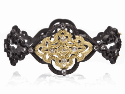 Collection: Old World Style #: 9377 Description: Old World blackened sterling silver/18k yellow gold large open scroll huggie bracelet with white diamonds and white sapphires.Metal: .925 Sterling Silver/18k Yellow Gold