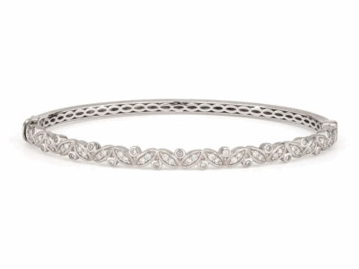 From the Sonoma Collection, the Sonoma Vine Diamond Bangle features pave and bezel set diamonds in 18K white gold. Diamond weight: 0.41