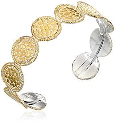 "Multi-disc gold-plated cuff with smooth sterling silver rim.  Dimensions: 1/2"" W"