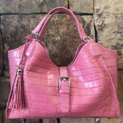 Our Shoulder -Pink Nile Crocodile is a handmade genuine exotic leather bag by 3rd generation leather artisans in California, all edges are hand painted, interior is garment suede and the bag has all italian palladium hardware.  Most bags come with a shoulder strap or can be customized to include one.  Please inquire via email or chat for more photos.