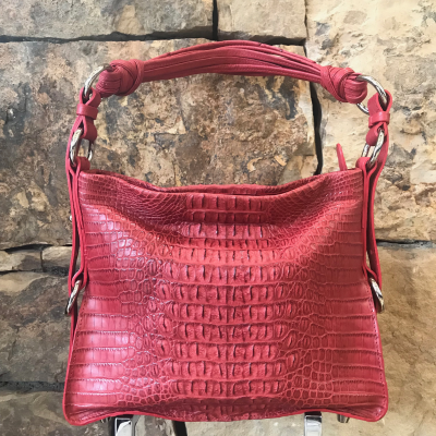 Everyday-Red Nile Crocodile Hornback  is a handmade genuine exotic leather bag by 3rd generation leather artisans in California, all edges are hand painted, interior is garment suede and the bag has all italian palladium hardware.   Most bags come with a shoulder strap or can be customized to include one.  Please inquire via email or chat for more photos.