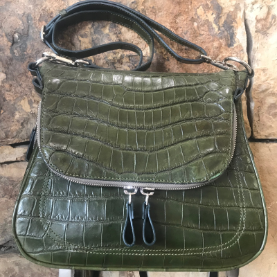"""LaNae's Zippered Messenger Handbag is made of genuine python and crocodile skin. Proudly handcrafted in the USA by 3rd generation artisans, all edges are hand painted, interior is garment suede and is detailed with Italian palladium hardware. The bottom zipper allows you to extend the size of the handbag. The fold over top has a zipper that can access a large private pocket that reaches to the bottom of the bag. The interior also has a zippered pocket and a cell phone pocket. The last pocket is under the fold over top for each access. It's complete with a adjustable 20"""" over the shoulder strap. Each luxury bag is one of a kind and especially made for you to stand out against the crowd!"""