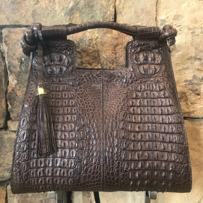 Brown Nile Crocodile Hornback Bag is a handmade genuine exotic leather bag by 3rd generation leather artisans in California, all edges are hand painted, interior is garment suede and the bag has all italian palladium hardware.   Most bags come with a shoulder strap or can be customized to include one.  Please inquire via email or chat for more photos.