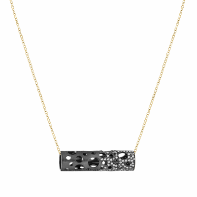 """A tube-shaped pendant punctured with circular cutouts of varying sizes features white diamond pavé adorning half of the pendant. Its delicate chain can be slipped through any hole to wear horizontally, vertically, or slightly off-kilter.   Features white or black diamond pavé embellishing half of the pendant. Pendant available in sterling silver and black rhodium-plated sterling silver. Adjustable (up tp 18"""") chain available in 18 karat yellow or rose gold or sterling silver.  Matte finish. Diamond Pavé approx. .9-1 tcw 3.4 wide x 9.8 long, 10g. Made in New York City from the world's finest materials and ethically-sourced diamonds. Please allow 3-4 weeks for delivery as each piece is created specially for you."""