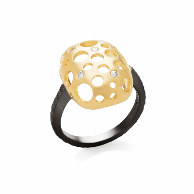 With a top that resembles a cushion cut diamond shape, this squared oval ring features circular cutouts of varying sizes that dot the design, adding negative space that traps several diamonds. The ring makes a bold statement but is light and comfortable to wear.  Available in all black rhodium-plated silver or 18 karat yellow gold with diamonds, as well as in a combination of both 18 karat yellow gold and blackened silver. Please inquire about any alternative metal color and diamond combinations. Top piece 15mm x 20mm, 9mm high; 2.5mm shank; 5g.  Diamonds approx. .09 tcw  Made in New York City from the world's finest materials. Please allow 3-4 weeks for your ring to reach you as it will be created just for you.