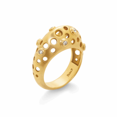This three dimensional ring makes an out-of-this-world impact but uses negative space to create a light feel on the finger. This ring is bold enough to wear alone but stacks well with other rings. Seven diamonds, set in raised bezels, sit sprinkled about the ring's surface, interspersed with the oculus cutouts.  Available in 18k yellow or white gold with diamonds (approx. .14ct) with matte finish. Weighs 8g; Top measures 1cm wide, 7.2mm tall; shank 4.7mm wide, 2mm thick Made in New York City from the world's finest materials and ethically-sourced diamonds.  Please allow 3-4 weeks for your order to arrive as each piece is created to order just for you.