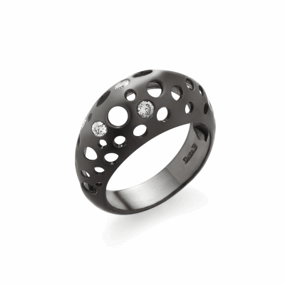 This three dimensional ring makes an impact but uses negative space to create a light feel on the finger. This ring is bold enough to wear alone but stacks well with other rings.   Available in reclaimed 18k white gold, or black rhodium-plated sterling silver, adorned with diamonds, of approximately .16 carats. 9g, top 1cm wide, .75cm tall; shank 4.7mm wide, 2mm thick Made in New York City from the world's finest materials and ethically - sourced diamonds. Please allow 3-4 weeks for your ring to reach you as each piece is created to order just for you.