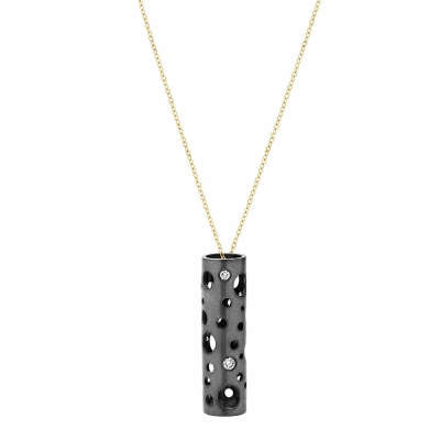 "This version of the Holly Pendant is a reinterpretation of the Holly seen in previous collections, first with no diamonds, and then with micropavé. It is a Dana Bronfman signature piece, this time offered with burnish-set diamonds, equally as versatile and classic.   Available in 18 karat yellow, white gold and black rhodium - plater sterling silver with diamonds.  7g -11g, 1.5 cm long x .6cm diameter Burnish-set diamonds (approx. .35 tcw) Adjustable (up to 18"") chain in 18 karat yellow gold  Made in New York City from the world's finest materials and ethically-sourced diamonds.  Please allow 3-4 weeks for your order to reach you as it will be created just for you."