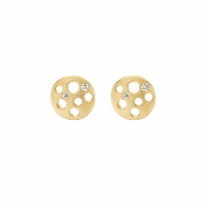 These slightly concave coin-shaped stud earrings act as talismans of good fortune for she who wears them. Matte-finished metal provides the perfect backdrop for a tiny sprinkle of sparkling diamonds in the coins' open space. They are light, comfortable, and versatile enough to wear every day.   Choose between matte-finished 18 karat yellow, white, or rose gold, or black rhodium-plated sterling silver. Features two burnish-set white diamonds in each earring, with a total carat weight of approximately .05. 7.6mm diameter, approx. 1g.  Made in New York City from the world's finest materials and ethically-sourced diamonds. Please allow approximately one week for the earrings to ship from our NYC studio as they are made to order specially for you.